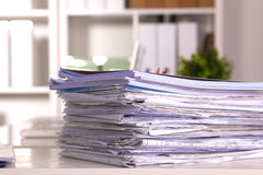 Office desk and a bundle of documents Stock Images