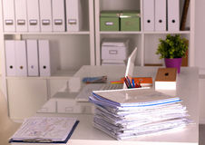 Office desk and a bundle of documents Royalty Free Stock Photography