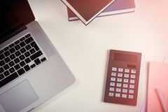 Office desk with laptop, calculator and notepad Royalty Free Stock Photos