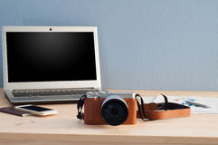 Office Desk with Camera and Office equipment Notebook, Cell Phon Stock Image