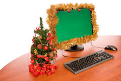 Office desk with Christmas decoration. Office desk with Christmas tree on white background royalty free stock photos