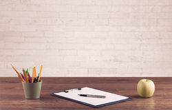 Office desk closeup with white brick wall Royalty Free Stock Photos