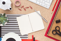 Office desk with coffe maker and open notebook. Top view. Stock Photography