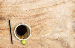 Office desk with coffee cup and pencil. Stock Image