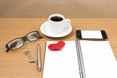 Office desk : coffee and phone with key,eyeglasses,notepad,heart Royalty Free Stock Photography