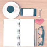 Office desk : coffee and phone with key,eyeglasses,notepad,heart Royalty Free Stock Photos
