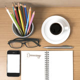 Office desk : coffee and phone with key,eyeglasses,notepad,penci Stock Photos