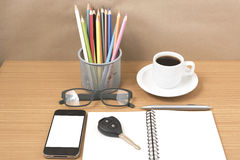 Office desk : coffee and phone with key,eyeglasses,notepad,penci Stock Images