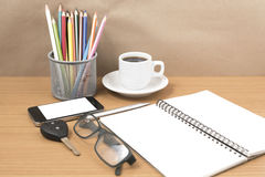 Office desk : coffee and phone with key,eyeglasses,notepad,penci Royalty Free Stock Photography