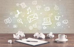 Office desk with communication icons Royalty Free Stock Photo