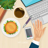 Office desk with computer, burger, coffee and laptop. Top view. Stock Photos