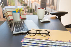 Office desk with computer and eyeglasses Stock Photography