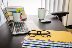 Office desk with computer and eyeglasses Royalty Free Stock Images