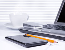Office desk with computer and smartphone Royalty Free Stock Photography