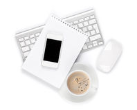 Office desk with computer, supplies and coffee cup Royalty Free Stock Photos