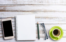 Office desk concept notebook and coffee Stock Images