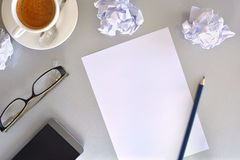 Office desk concept search for ideas in business top view. Concept search for ideas in business. Blank sheet on gray office table with crumpled sheets, coffee Royalty Free Stock Image