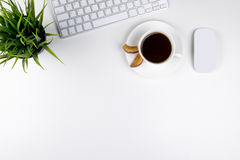Office desk with copy space. Digital devices wireless keyboard and mouse on office table with cup of coffee, top view Royalty Free Stock Image