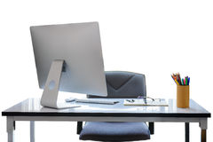 Office desk with desktop computer, cup of coffee and office equi. Pment isolated on white background with clipping path Stock Image