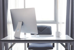 Office desk with desktop computer, cup of coffee and office equi. Pment in office workplace Royalty Free Stock Images