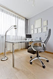 Office with desk and diplomas Stock Image