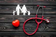Stethoscope and heart for diagnostic and cure of heart disease on wooden background top view. Office desk for doctor. Health care concept. Stethoscope and heart royalty free stock image