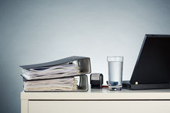 Office Desk with Documents and a Computer Royalty Free Stock Image