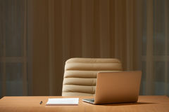 Office desk in empty room stock photography
