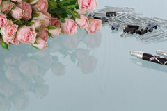 Office desk feminine. With roses Royalty Free Stock Photo