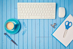 Office desk flat lay with keyboard, coffee cup and notebook. View from above. Stock Photography