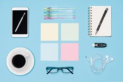 Office desk flat lay. Top view of working space table with morning coffee, smartphone and stationery, office supplies. Office desk flat lay. Top view of working royalty free stock photo