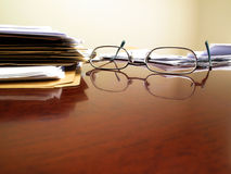 Office Desk and Glasses Stock Photo