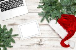 Office Desk Keyboard Laptop Notebook Tablet PC Christmas Decoration. Office Desk with Keyboard Laptop Notebook Tablet PC and Christmas Decoration. Business stock photography