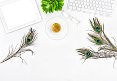 Office desk keyboard, tablet pc, coffee, green plant Royalty Free Stock Photography