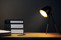 Office desk with lamp and ring binders. Office desk with lamp, ring binders and mobile phone stock photo