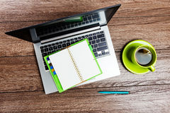 Office desk with laptop computer, planner Stock Image