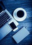 Office desk with laptop computer. Planner, mobile smartphone and coffee cup stock images