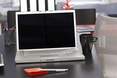 Office desk with laptop Stock Images
