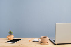 Office desk with laptop, Note paper, Euphorbia milii flower on terracotta flower pot . Stock Images