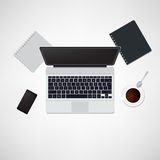 Office desk with laptop. Notepad, tablet, smartphone and coffee cup top view background Stock Photos