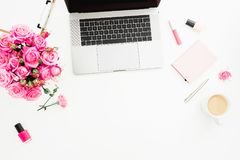 Office desk with laptop, pink roses bouquet, coffee mug, pink diary on white background. Flat lay. Top view. Fashion or freelance. Office desk with laptop, pink stock photography