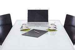 Office desk with laptop ready for business meeting Royalty Free Stock Images