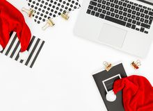 Office desk laptop red Christmas decoration Business Holidays. Office desk with laptop and red Christmas decoration. Business Holidays Royalty Free Stock Photo