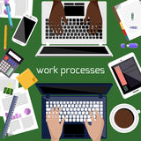 Office desk with laptop, smartphone, stationery Stock Images