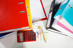 Office desk littered with papers. Royalty Free Stock Photos