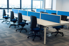 Office desk. Many chairs in office open space stock images