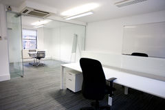 Office desk with meeting room in background Royalty Free Stock Photo