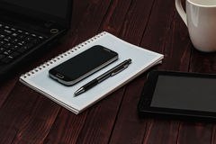 Office Desk Mock Up Template with Laptop, Notebook and Tablet. View from Above Royalty Free Stock Photos