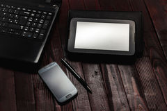 Office Desk Mock Up Template with Laptop, Notebook and Tablet. View from Above Stock Image