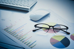 Office desk at morning with a  financial documents Stock Image